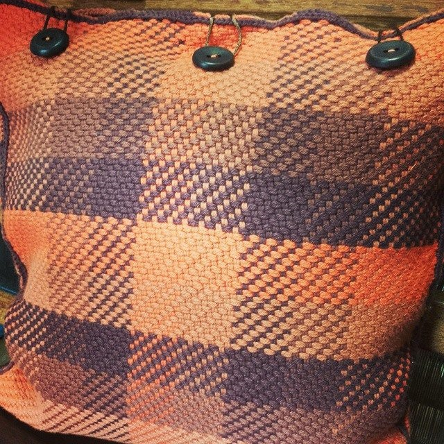 Handwoven cushion cover woven on a frame loom