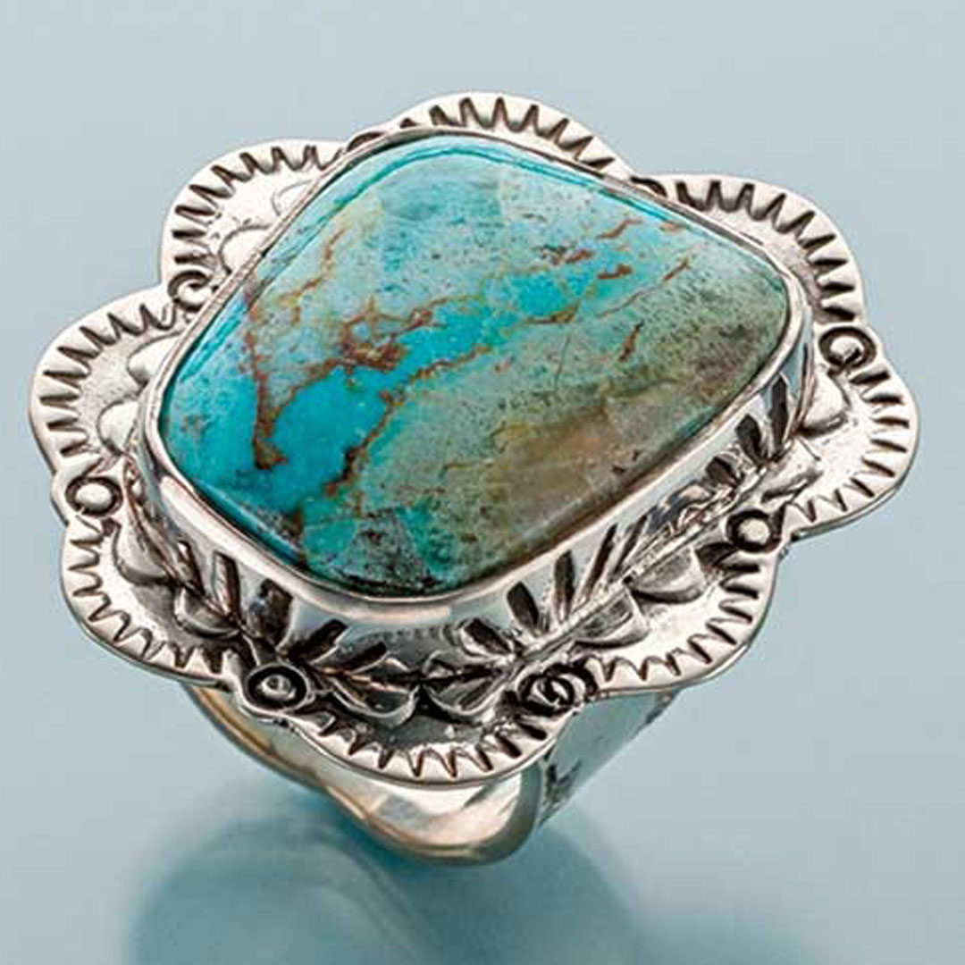 stamped metal jewelry: Jeff Fulkerson Stamped Bezel Ring Sterling silver, turquoise PHOTO: JIM LAWSON