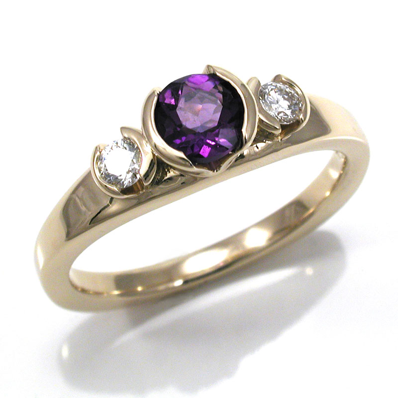 amethyst gemstones: A relatively small amethyst can carry a lot of punch due to the intensity of the color and the accent diamonds. Courtesy Gary Swank Jewelers, Portland, Oregon.