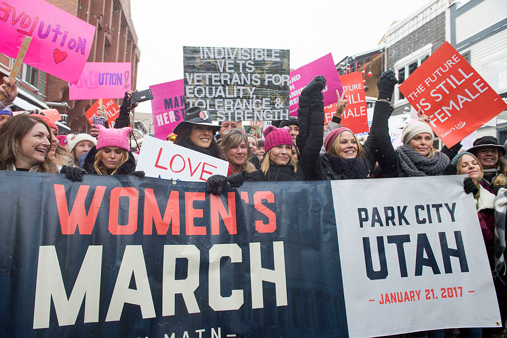 Chelsea Handler (C) and Charlize Theron (2nd R) participate in the Women's March on Main Street during the 2017 Sundance Film Festival in Park City, Utah, January 21, 2017. / AFP / VALERIE MACON