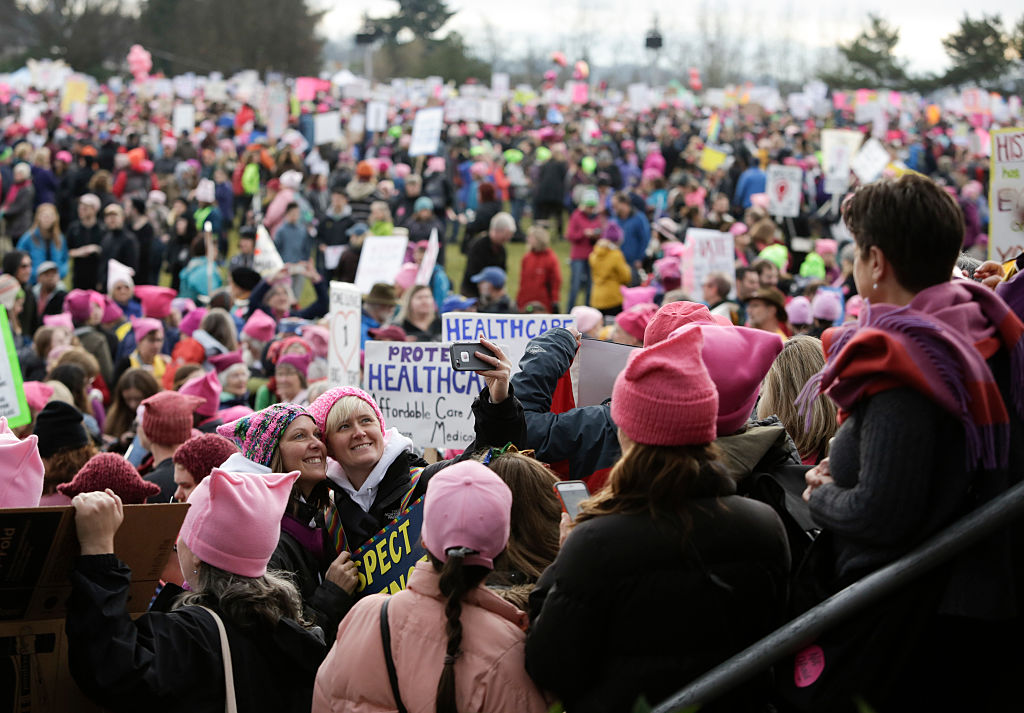 People gather at Judkins Park during the Women's March in Seattle, Washington, on January 21, 2017. Photo credit: JASON REDMOND/AFP/Getty Images