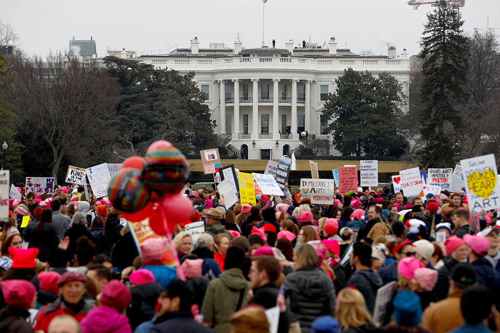 Protesters gather near the White House during the Women's March on Washington January 21, 2017 in Washington, DC. (Photo by Aaron P. Bernstein/Getty Images)