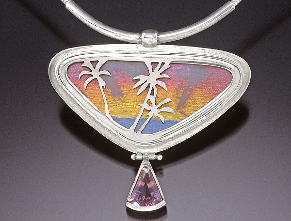 jewelry design: This pendant, titled Going Home, is a vivid example of Noël's signature scenics using anodized titanium and pierced silver overlays; photo by Larry Sanders, Sanders Visual Images