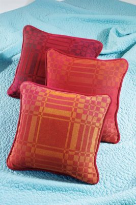 Handwoven Digital Collection: Sarah Jackson weaves cheery pillows in a 2-block turned twill pattern.