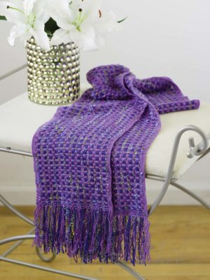 A huck scarf with novelty yarns.