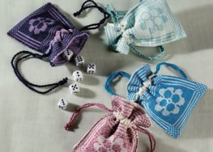 These tiny handwoven bags are perfect for farkle or other dice games.