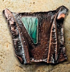 A fold-formed bronze brooch by Helen Driggs. Photo by Jim Lawson.