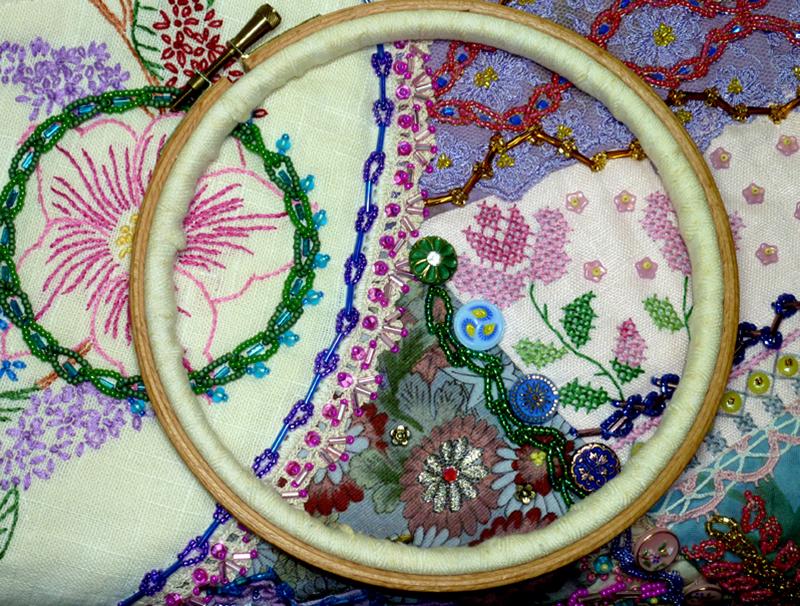 Hoop and beaded fabric, by Nancy Eha