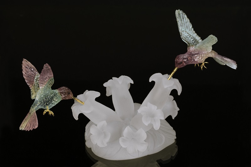 These bi-color tourmalines have been used to delightful effect in this hummingbird sculpture. Sculpture by Herbert Klein Carvings in Idar-Oberstein, Germany. Photo Mia Dixon, courtesy Pala International.
