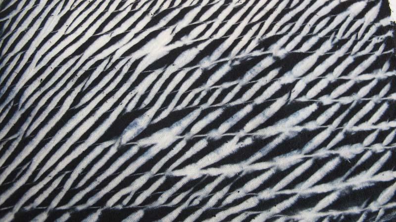 Arashi shibori patterns look like rain on a windowpane.