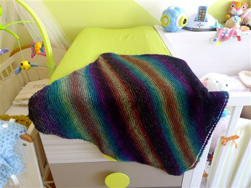 Knit this sock yarn baby blanket with this knitting pattern.