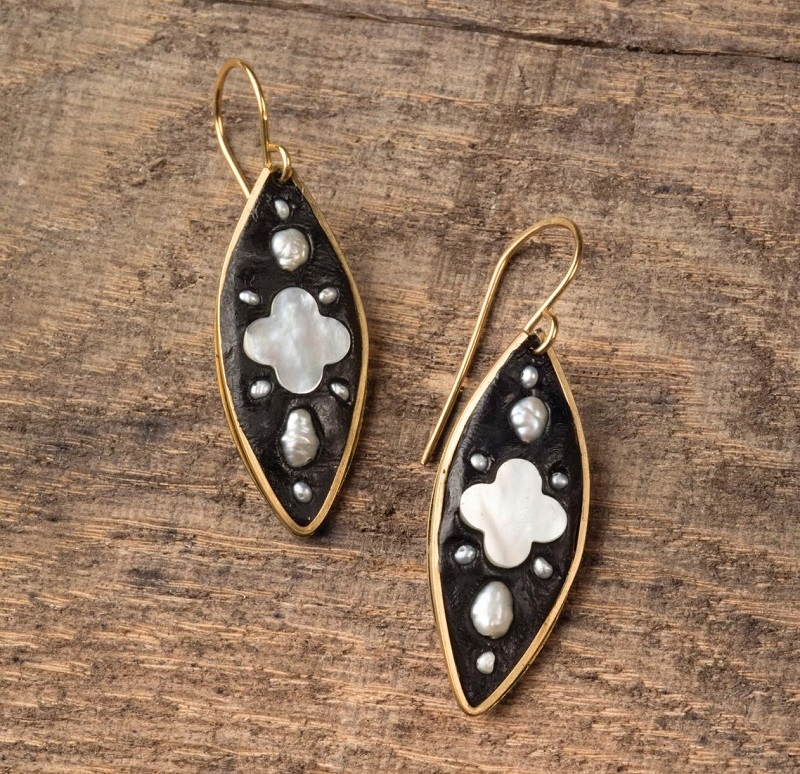 pearl, mother-of-pearl and epoxy clay inlaid earrings by Anne Potter