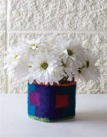 The Intarsia Box is a a knitted box that you can put flowers or other items within.