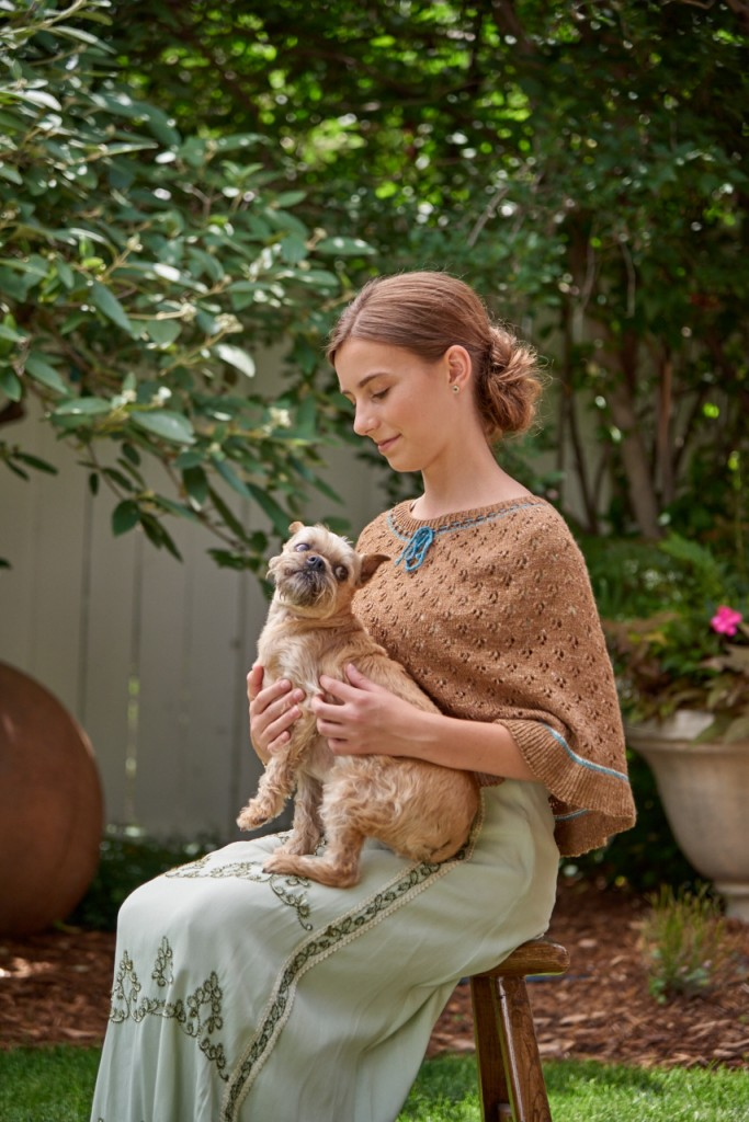 Our models have to put up with a lot at shoots: heat, warm clothing, editors who want to photograph them with dogs. Fortunately, this young lady makes it all look easy while wearing Elizabeth's Delight Capelet.