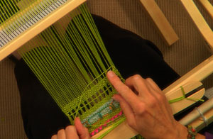 Jane Patrick weaves ribbon and lace on her rigid heddle loom