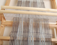 TIP: A keeper string can help you tame crossed warp threads.