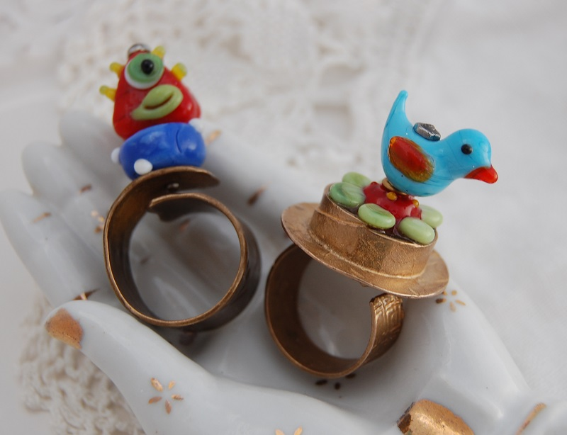 mixed media jewelry: lampwork glass rings by Jen Cushman