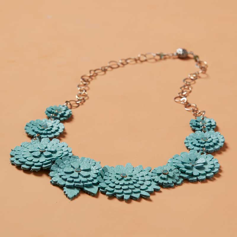 Jill MacKay's carnation necklace made using leather and the Sizzix machine.