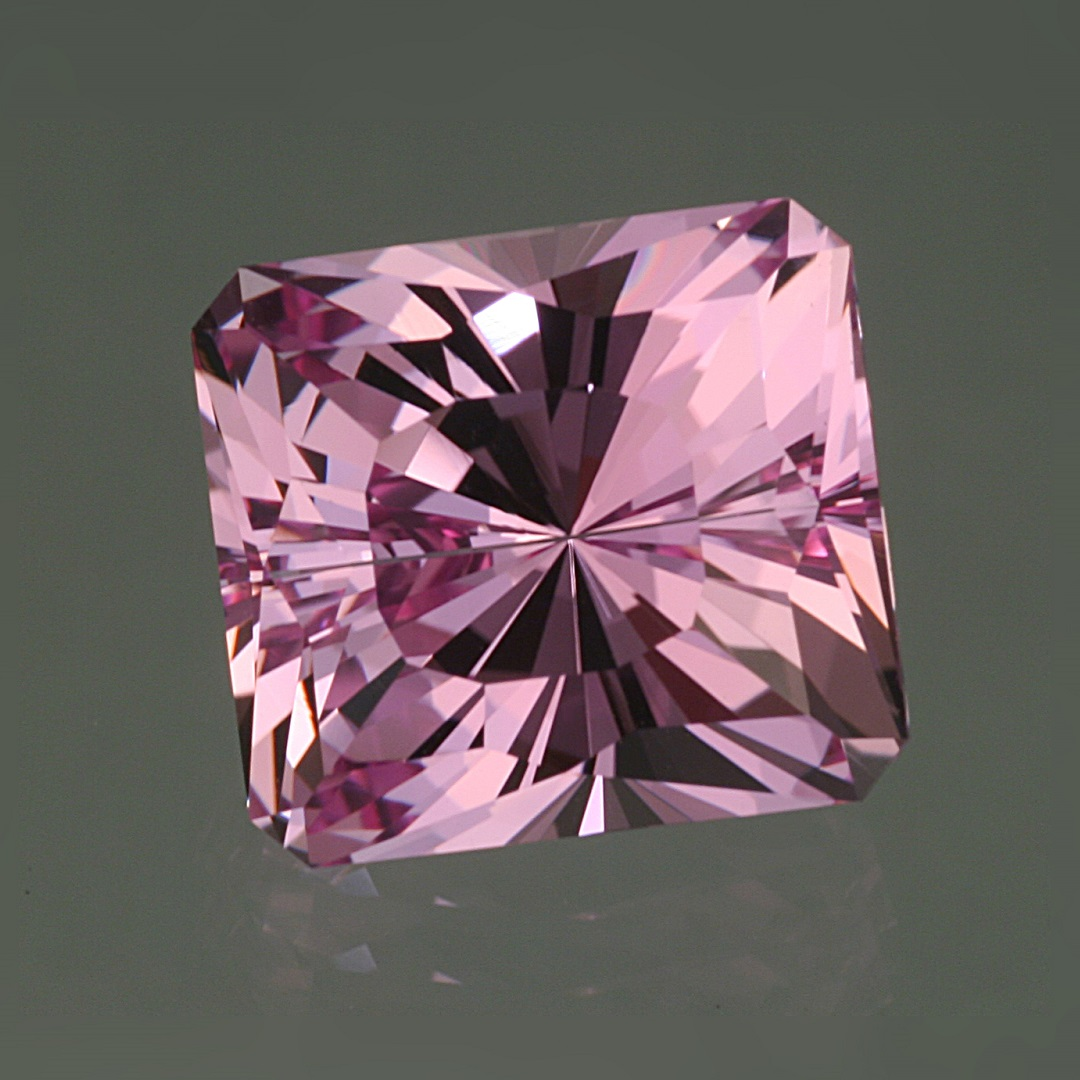 pink gemstones: Pink topaz is one of the prettiest of pink gemstones. This stone from around the town of Ouro Preto in Brazil, cut by John Dyer, won second place in the All Other Faceted Category of the AGTA Spectrum/Cutting Edge Awards in 2014. Photo by David Dyer, courtesy John Dyer Gems.