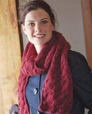 Learn how to make a knitted scarf the right way in Knitting Daily TV Episode 301 by watching knitting experts make a reversible cable-scarf.