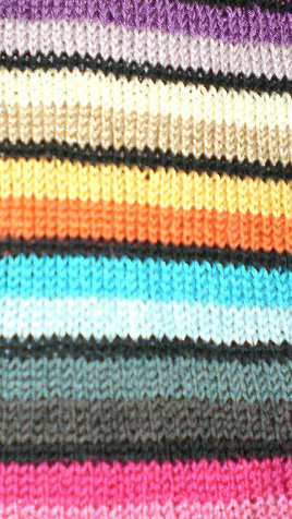 Learn how to knit stripes in circular knitting without those unsightly jogs at the ends of your rounds!