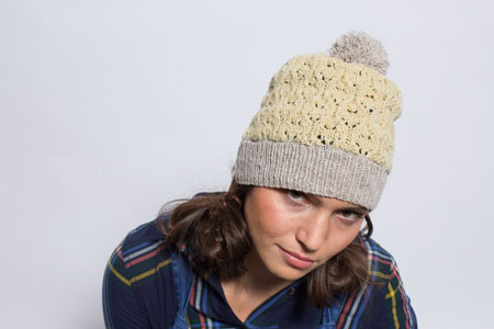 You'll love knitting this knitted hat that involves an elegant lace motif that shines in a subtle neutral color that's perfect to wear from fall to spring!