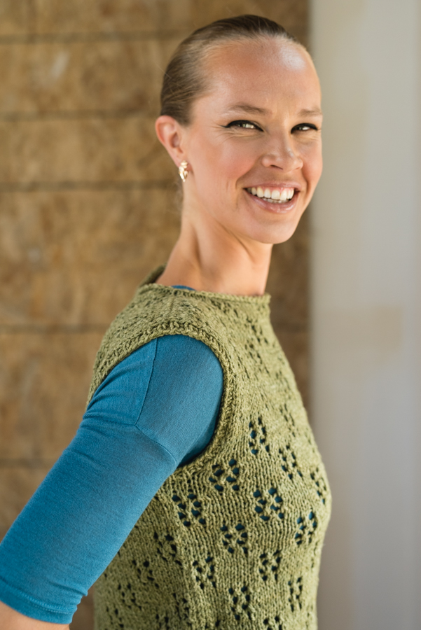 An open eyelet pattern creates a checkerboard effect in this bottom-up knitted tank. This loose-fitting top is worked in pieces and seamed for stability.