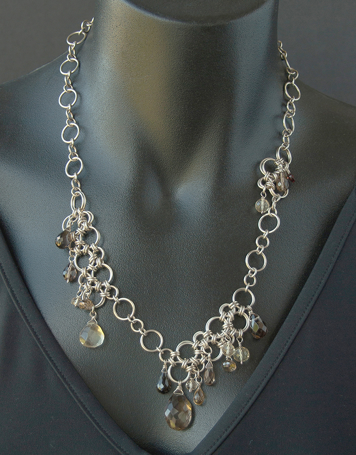 Embellished chain maille necklace with citrine quartz, smoky quartz, and garnet; photo: Kylie Jones.