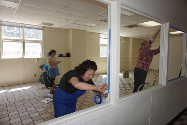 Local Cloth members are preparing the new studio for dyers. Photo: Judi Jetson.