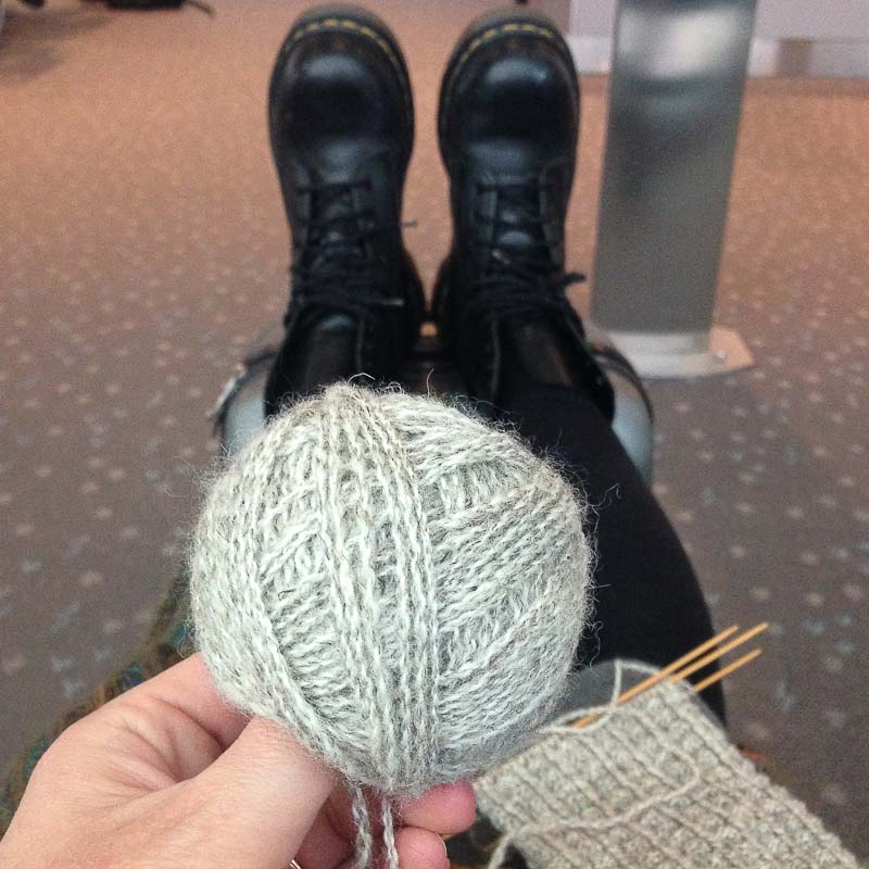 Planes, trains, and automobiles. I even wind yarn while waiting on the lambs to arrive. Photo by Kate Larson