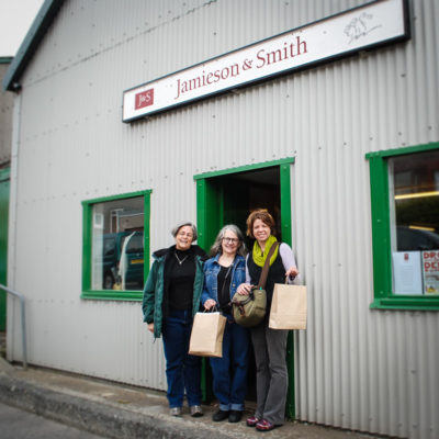 Happy spinners in Lerwick, Shetland. From left: Kathy Peoples, Deb Totten, and Kate Larson.