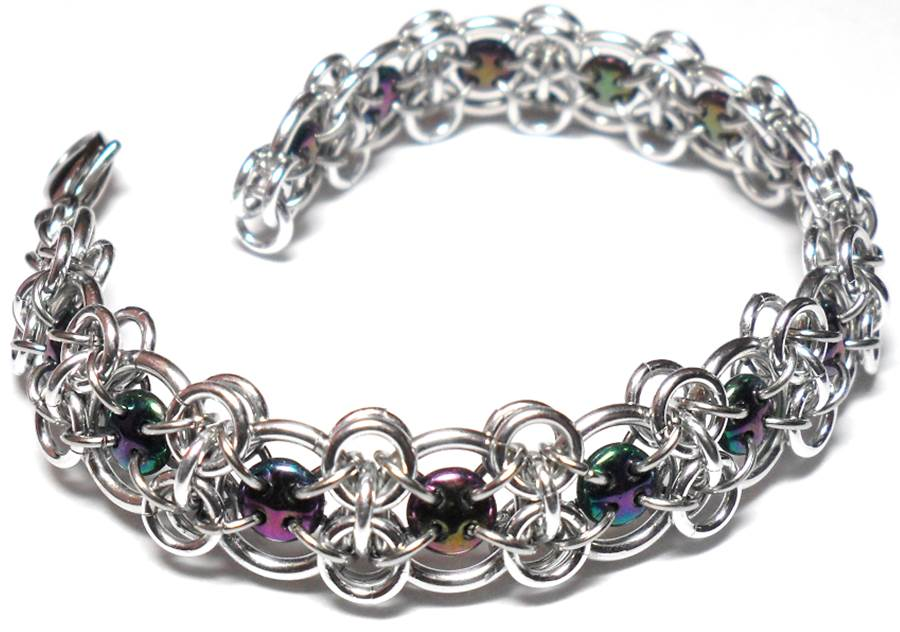 Chain Maille Jewelry Design: It's All About the Unit. Lattice bracelet by Michelle Brennan, with bright aluminum and purple iris quadralentil beads; photo courtesy of the artist