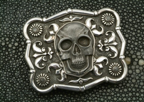 """Arnold's Skull"" Belt Buckle by Lee Downey. Sterling silver, Damascus steel skull. Photo courtesy of Lee Downey."