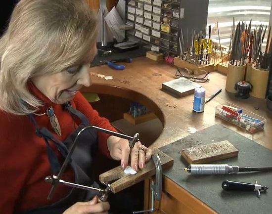 Lexi Erickson sawing with a jeweler's saw