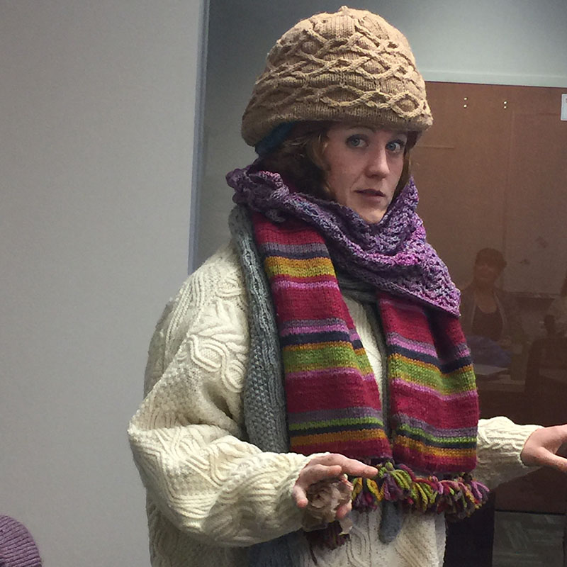 Want to stay cool this summer? Do the opposite of Lisa Shroyer, who wore over a dozen knitted items in our office handknits contest. Photo by Deb Gerish.