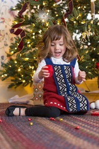 This sweet knitted dress for a little girl would make a perfect holiday gift!