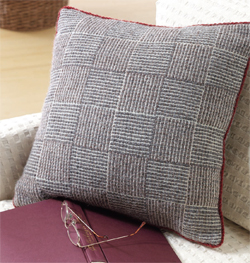Pillow handwoven in log cabin with natural-colored wool