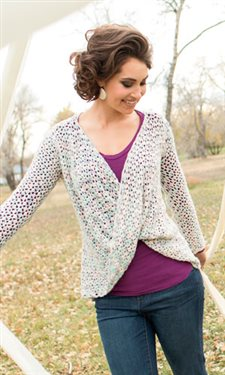 This lace crochet sweater is very flattering.