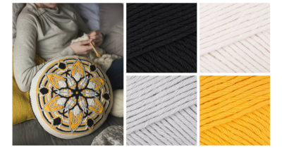 The Mandala Cushion from Interweave Crochet Fall 2018 in Paintbox Cotton Aran in pure black, champagne white, stormy grey, and mustard yellow. | Photo Credit: Harper Point Photography and Paintbox Yarns)