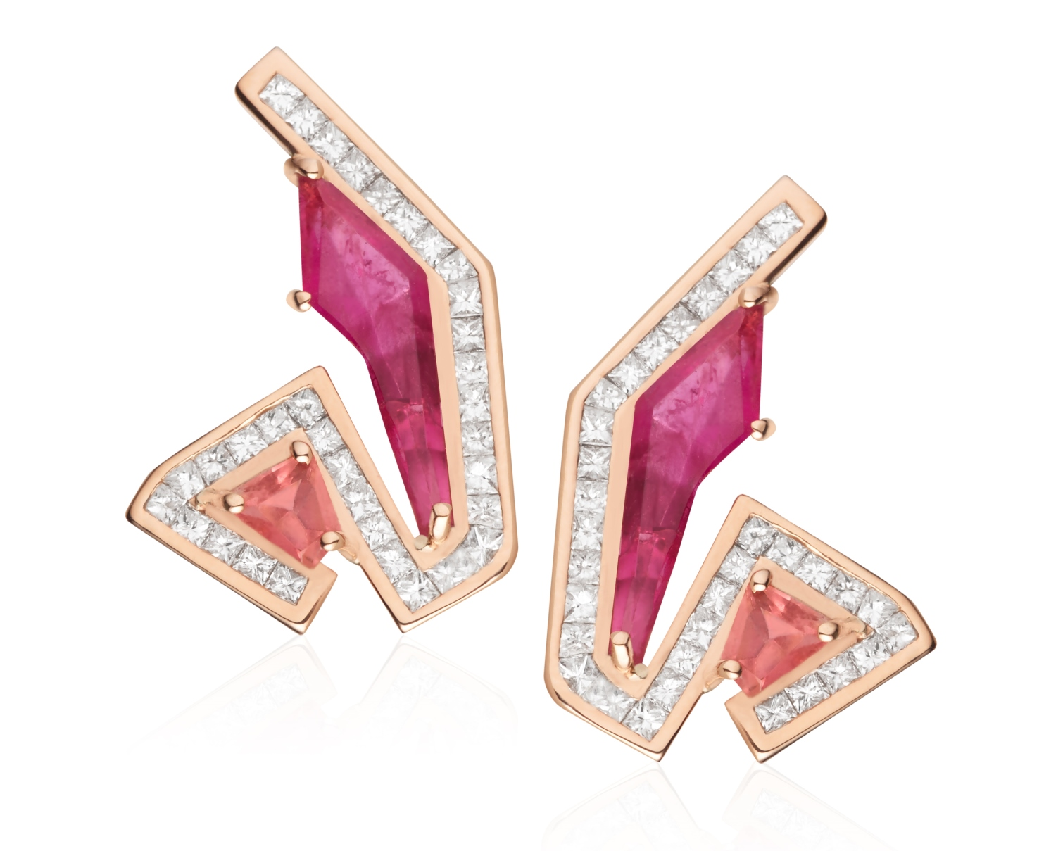 Marcia Budet's earrings in 18K yellow gold with amethyst, pink tourmaline, and diamond baguettes, feature bold shapes and vibrant colors. Seen in in Lapidary Journal Jewelry Artist September/October 2018; photo courtesy Marcia Budet