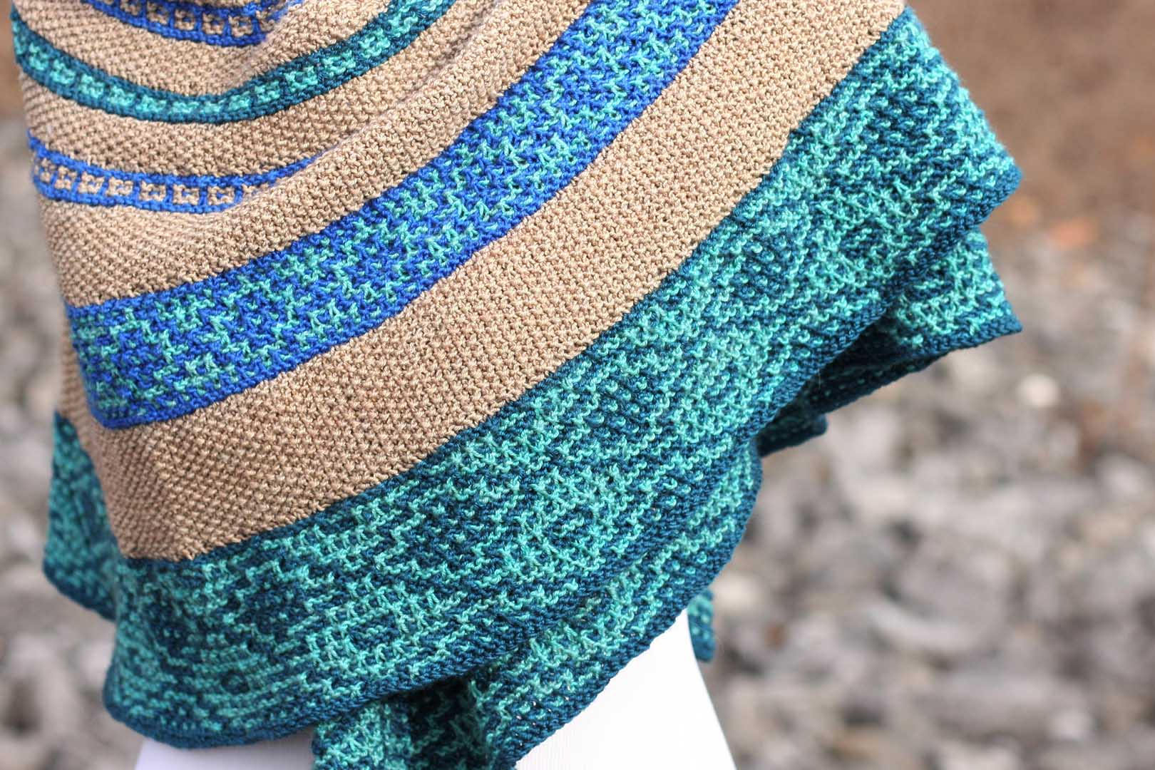 Simone's educational background in art and languages is evident in Markanda, a mosaic slip-stitch shawl that reflects the beauty of the ancient bazaars along the Silk Road, a network of ancient trade routes that connected East Asia and Southeast Asia with East Africa, West Asia, and Southern Europe.