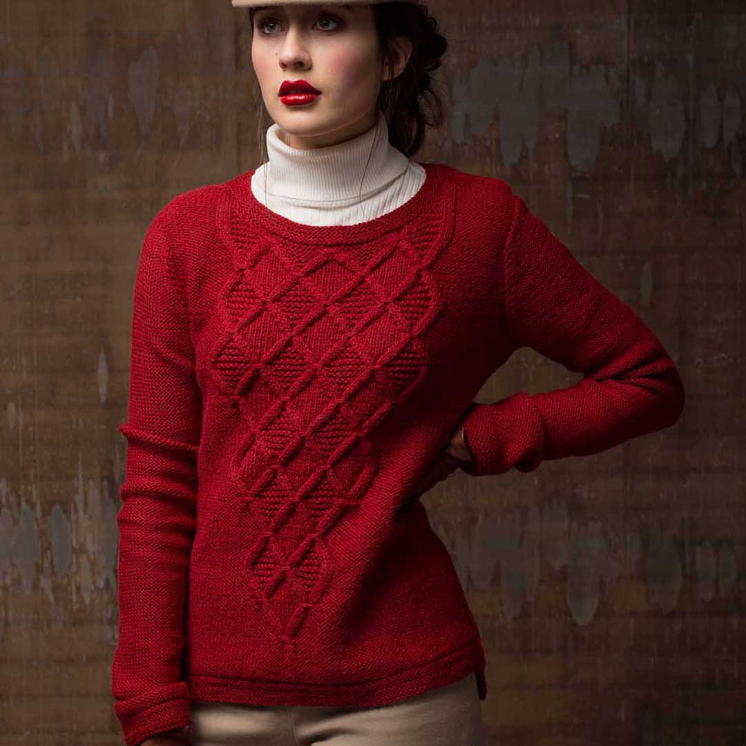 the Massachusetts Ave Pullover is a stunning design that features knitted cables