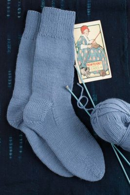 "Ann Budd's ""Man's Medium-Sized Sock"" from the 1918 booklet, How to Knit (Philadelphia: Dr. D. Jayne & Son). The booklet is shown at left. Photo by Joe Coca."