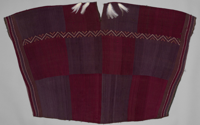 Man's camisa (tunic), Chile, Arica (?), 16th–17th century. Camelid hair, feathers; discontinuous warp and warp patterning, 35. x 54. in. Metropolitan Museum of Art, gift of John B. Elliott through the Mercer Trust, 2000 (2000.160.25).  Photo © The Metropolitan Museum of Art. Image source: Art Resource, NY.