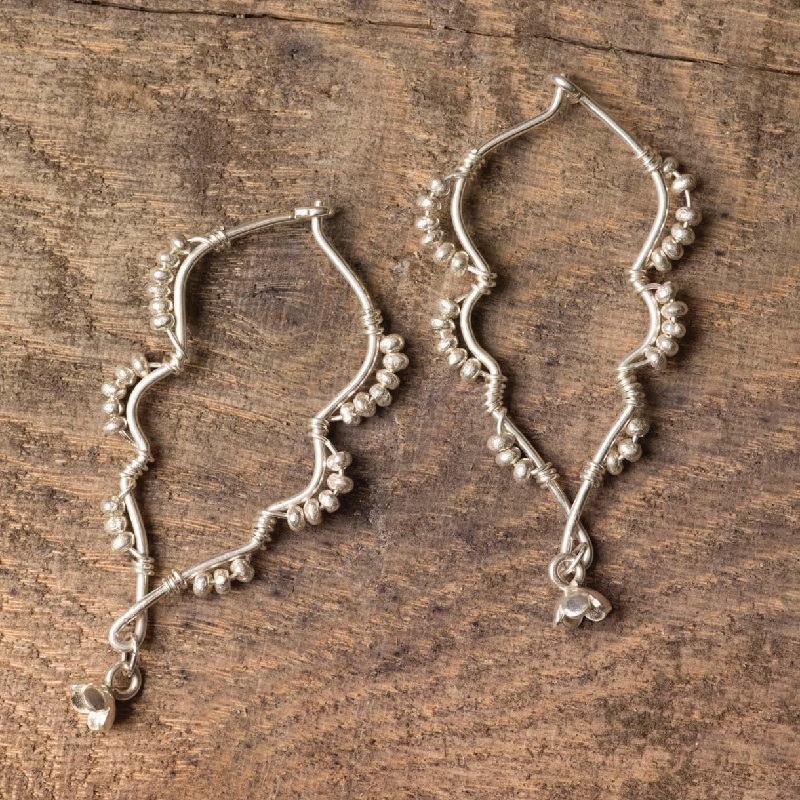 Moroccan-inspired silver wire and bead earrings by Anne Potter