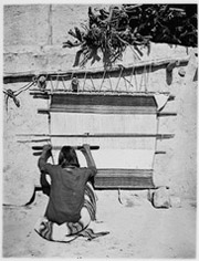 A Navajo weaver at work