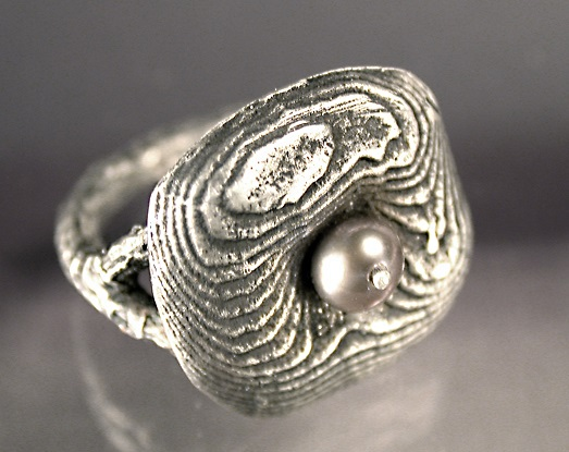metal casting: sand and cuttlebone cast ring by Noel Yovovich