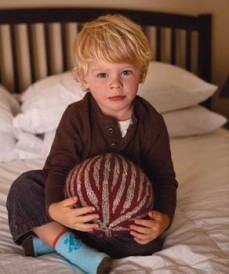 Make this knitted toy pattern called the Nordic striped ball.