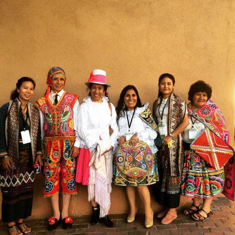 Members of Ock Pop Tok pose at the International Folk Art Market in Santa Fe, which the group has attended for the past 9 years. Photo by Ock Pop Tok.