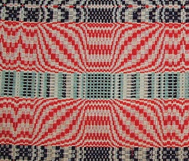 Overshot coverlets like this one are a major part of American weaving history.